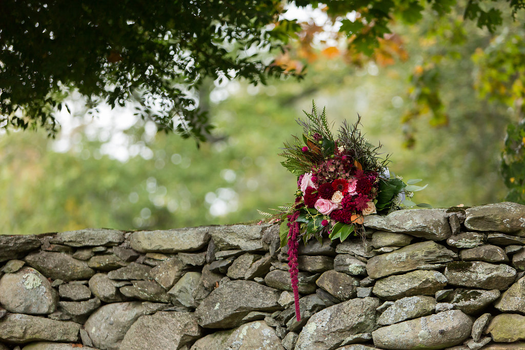 hanging amaranthus, astilbe, roses, lisianthus, magnolia leaves. photo taken by  ali rosa photography