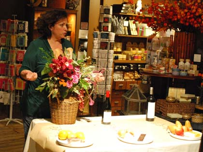 Lisa pairs wine with complementary cheese and fruit and a handsome basket arrangement for a casual event.