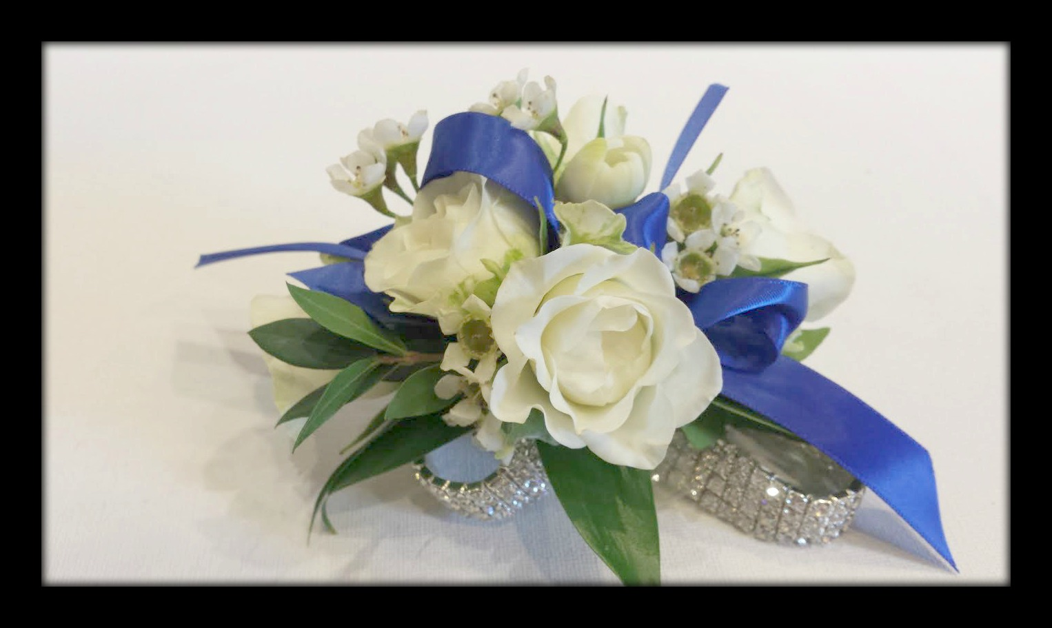 white rose on rhinestone band blue ribbon